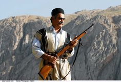 A Bakhtiari tribal man in his traditional Ashayer Outfit holds a Rifle.The Bakhtiari are a southwestern Iranian Tribe.