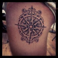 The idea I'm mostly leaning towards is a nautical compass. I like the shading a LOT on this design; not too dark, yet done with only black ink. It's a little too busy for me, but I really like the overall style. I also want some kind of a victorian-esque border on mine, but maybe one not so gaudy?
