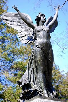 "My photograph of an angel monument in Green-Wood Cemetery, Brooklyn, New York. The angel was sculpted by the Italian born artist Adolfo Apolloni, (1855 - 1923), who sculpted several other funerary monuments, found both in the United States and Italy. His name appears on the eastern side of the base of the angel, along with the word ""Roma."""