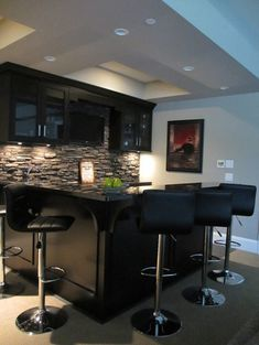 Bars For Basements sleek basement bar features black cabinets paired with gray