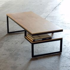 Gus Modern Coffee Table    -- perfectly minimalistic with a simple storage component underneath. http://surplusmag.com/