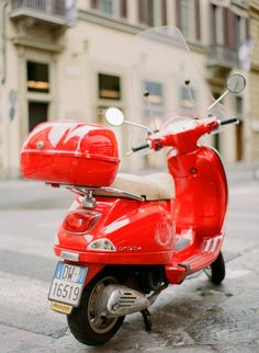 bright red Vespa = love   by Peter and Veronika