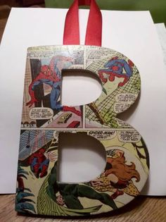 comic book letters - a little mod podge combined with comic book pages or wrapping paper/scrapbook paper - great for a boy's wall/name/lettter. Cool party accent decor for the superhero themed birthday party.