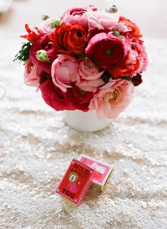 While flowers are essential for any event. Try red and pink ranunculus instead. #hopeathome Photo by Lisa Marie Photo