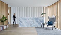 Love the mixed use of materials, marble, design accent behind wall, and wooden panelling