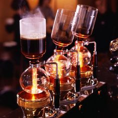 siphon coffee maker...this is neat, but if I made it at home, my family would think I was cooking meth