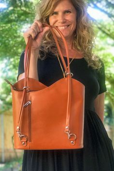 Standout with this Italian leather beauty! Carry over the shoulder or pull the straps outward to carry as a backpack for the handsfree option. The zip closure keeps your valuables secure. Inside and outside zip wall pockets. The wide bottom makes for a roomy bag. Great addition to your professional attire. #leatherhandbags #madeinitaly #pursesandhandbags #luxurybag #fashionstyle #fashionbag #workbag #handbagaddict #leatherbackpack How To Make Handbags, Purses And Handbags, Backpack Purse, Leather Backpack, Italian Leather Handbags, Convertible Backpack, Professional Attire, Wall Pockets, Luxury Bags