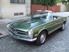 Google Image Result for http://www.musclepricecars.com/muscleCarImages/1968_mercedes_benz_280sl.jpg