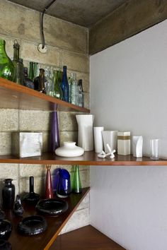 The 'Brutalist'  home of late Japanese-born artist, Tomie Ohtake  | Designed by her son, architect Ruy Ohtake, in the 1960s | Corner Shelving in kitchen |  São Paulo, Brazil |