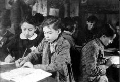 Lithuania ,Kovno, Jewish girls learning in the ghetto, 1943. The ghetto did their best to keep life as normal as possible. School was taught ( though not allowed) inside the walls. Sad part is these beautiful children will be murdered by nazi men and women