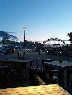 This is the view from Pitcher & Piano on the Quayside of Newcastle Upon Tyne. In the background is the Tyne Bridge, with the Sage Gateshead music venue.