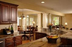 Kitchen of the Day: A beautiful kitchen remodel with cherry cabinets, architectural posts, and a large two-tier island... Photo #23 in Traditional Dark Cherry Kitchens