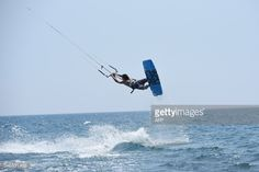 A kitesurfer jumps of the water as he practises on the waves of... #ulcinj: A kitesurfer jumps of the water as he practises on the… #ulcinj