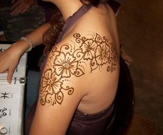 henna shoulder tattoo. Perfect but not as big..maybe just one or two of the flowers on my shoulder blade..