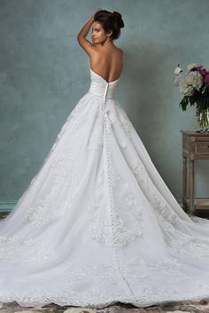 Love the back of this ball gown wedding dress by Amelia Sposa 2015!