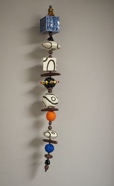 Hanging totem by One Blue Marble