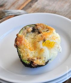 Baked Eggs in Avocado Cups Recipe: half avocado, egg, cheese, s Preheat oven to 450, crack egg into avocado center, sprinkly with cheese and s, bake 15 min. Top with salsa. @jen Price - someone made these for the brunch yesterday - so good and paleo/low-carb friendly!