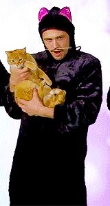 James Franco, as a cat. Dancing with a cat. I don't necessarily understand it, but I like it.