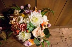 A soft palette of dahlias, roses, clover and hydrangeas, with accents of succulents and fiddle heads, are a beautiful complement to this rustic chic country wedding at the Historic Barns of Nipmoose. Trisha Millier Photography, Flowers by Blooms for Rooms