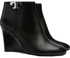 Tory Burch Brand New In Box Lowell Wedge Heel Leather BLACK Boots. Get the must-have boots of this season! These Tory Burch Brand New In Box Lowell Wedge Heel Leather BLACK Boots are a top 10 member favorite on Tradesy. Save on yours before they're sold out!