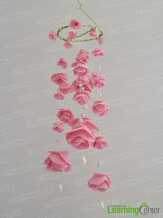Wanna make some beautiful wind chimes for your house at weekends? How about this beautiful pink rose wind chime with pearl dangles?