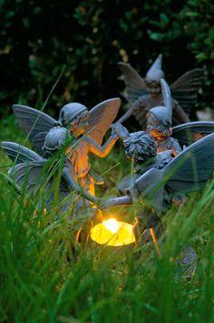 Garden lighting at night. Faeries dancing around candle.still love faeries. Garden Night Lighting, Enchanted Garden, My Secret Garden, Secret Gardens, Parcs, Garden Statues, Garden Sculpture, Fairy Land, Fairy Houses