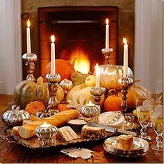 Autumn tablescape with silvered pumpkins and fall leaves.