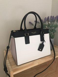 100 Authentic Kate Spade Cameron Bright White/Warm Beige/Black Medium Satchel Brand new with tags 11 in (width) x in (height) x 6 in (depth) Handles are 4 inches drop Long shoulder strap included Kate Spade Handbags, Prada Handbags, Fashion Handbags, Purses And Handbags, Fashion Bags, Handbags Online, Fashion Goth, Handbags Michael Kors, Leather Handbags