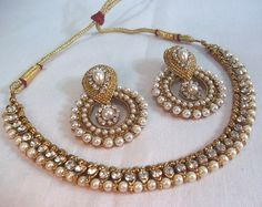 Shop Golden Pearl Polki Necklace Set by Shree Mauli Creation online. Largest collection of Latest Necklaces online. Indian Jewelry Sets, India Jewelry, Pearl Jewelry, Jewelery, Gold Jewellery, Pearl Necklaces, Tika Jewelry, Indian Accessories, Statement Jewelry