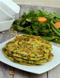 Chana Dal Pancakes, soaked chana dal mixed with vitamin rich vegetables and protein rich curds to enhance its taste. Grated ginger and green chillies add the much-needed spice to the pancakes -- Tarla Dalal Veg Recipes, Indian Food Recipes, Vegetarian Recipes, Snack Recipes, Dinner Recipes, Cooking Recipes, Healthy Recipes, Healthy Snacks Vegetarian, Indian