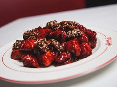 The Beijing chicken comprises walnuts and a sweet brown sauce. Upscale Restaurants, Brown Sauce, Beijing, Beef, Chicken, Food, Meat, Pekin Chicken, Hoods