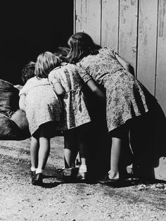 unknown photographer, four girls looking into barn, sometime between 1930-1949