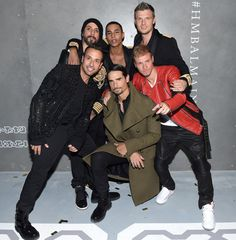 Brian Littrell Photos Photos - A. J. McLean, Howie Dorough, Kevin Richardson, Brian Littrell, and Nick Carter of the Backstreet Boys pose with Creative Director for Balmain Olivier Rousteing (C) at the BALMAIN X H
