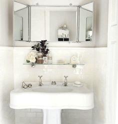 Subway tile, vintage sink, 3-way mirror