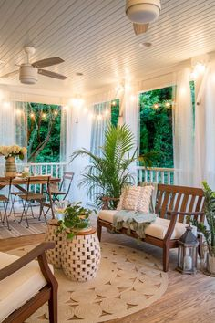 Roommates Decor A tropical boho back porch decorated for summer with breezy functional style and string lights for evening ambience. Decor A tropical boho back porch decorated for summer with breezy functional style and string lights for evening ambience. Home Porch, House With Porch, Porch Roof, Outdoor Rooms, Outdoor Living, Outdoor Patios, Outdoor Kitchens, Outdoor Seating, Indoor Outdoor
