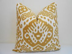 Gorgeous Ikat pattern by Nate Berkus. The color is rich/ gold with an ivory background cover in golden yellow and cream. The fabric is 55%