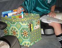 I'm thinking of just using spray adhesive to cover an empty diaper box to do something like this.  I may not be able to have pockets on the outside, but I won't have to sew anything either, maybe. :)