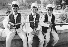 Albanian boys - White, full-sleeved shirts and felt hats such as those seen here are major components of the Albanian traditional dress for males, which is influenced heavily by Turkish fashions.