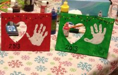 Handprint picture frame, with puffy paint Christmas lights. We did this tonight with all the kids!