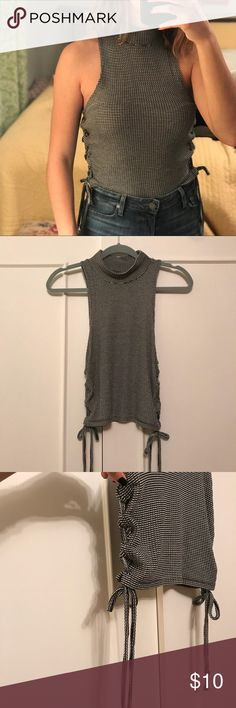 sleeveless crop top black and white striped crop top  sleeveless with mock neck lace up on sides   super stretchy comfy material One size   perfect condition never worn! Tops Crop Tops