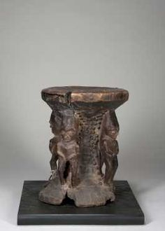 "A fine and rare Pende stool - Pende DR Congo H: 11"" The unusual stool with four caryatids, each carved differently, and the area between them decorated with hobnails. The stool seat emerging from the rough block. Well worn patina. Fine and old."