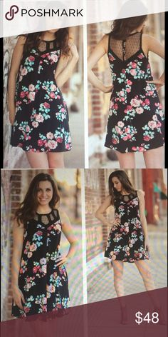 """Black Floral Mesh Tunic Dress in various sizes Unique black floral mesh tunic dress in sizes small, medium, and large. Beautiful lace on top front and back. Split back with 5 button closure. 100% rayon. BUST: S-17"""", M-18"""", L-19"""". LENGTH: S-34"""", M-35"""", L-36"""". Great casual summer dress. Loose fit makes it very comfortable! Dresses Midi"""
