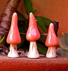 In this listing I have this tiny little set of 3 hand sculpted Mushrooms.