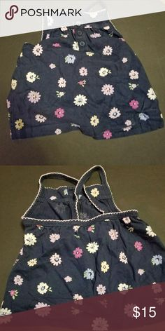 Baby gap 6 or 12 month tank top floral This baby gap floral tanktop features fixed buttons on the front it is in good used condition and is 6 to 12 months  A-2-15 GAP Shirts & Tops Tank Tops