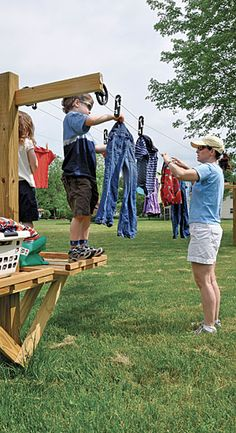 Pulley clothesline with shelves for basket and kids to stand to help.