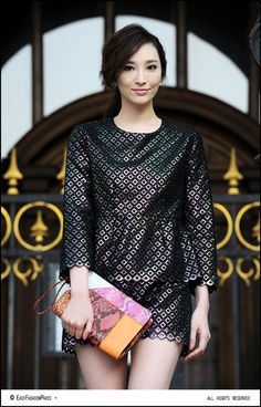 Pace Wu in Paris. Reptillian Chic. And that bag is aces.