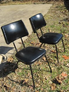 Set of vintage mid-century minimalist modern black synthetic leather chairs