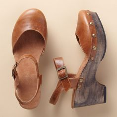 """MARIKA SANDALS--Mary Jane meets the clog, in chestnut vegetable-tanned leather with the iconic ankle strap and a polished wood platform wedge. Cushioned leather insole, rubber sole. Imported. Euro whole sizes 36 to 41. 36 (US 6), 37 (US 7), 38 (US 8), 39 (US 9), 40 (US 10), 41 (US 11). 2-3/4"""" wedge on 1"""" platform."""
