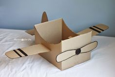 Let their imaginations take flight with this super simple cardboard box airplane! I honestly was able to put this together in less than 30 minutes and the kids have been playing with it for over 2 hou #toysforkids