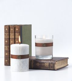 Southern Persimmon Candles by Aromatique- The scent of Orchard Fruits Entwined with Tangerine and Musk. Seen here: Candle in Glass and Pillar Candle